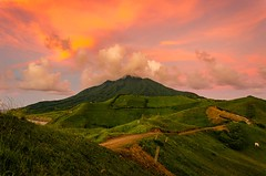 The bashful Mount Iraya (Pipo De Jesus) Tags: 500px mountain volcano clouds sunset sunsets orange sky skies green lush peace solitude idyllic philippines batanes batan island iraya hills vayang travel destination tropical tours south east asia