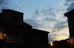 di quando era ormai sera ma avevo un rullino da finire. (piermario) Tags: sardegna light sky silhouette festival clouds 50mm evening nuvole sardinia case contax cielo luce skyer sera seneghe 139quartz montiferru settembredeipoeti cabudannedesospoetas partzadesosballos piazzadeiballi