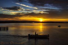 Matlacha Sunrise (tropicdiver) Tags: usa gulfofmexico clouds sunrise boats fishermen florida matlacha constructionworker pineisland pineislandsound