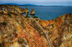 Colorful Cliff (rschnaible) Tags: ocean sea cliff seascape color portugal water coast seaside sandstone colorful europe day view sunny cliffs lagos atlantic southern western vista geology algarve the geologic nrpad