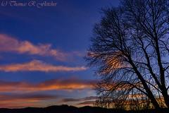 Colorful Sunrise (travelphotographer2003) Tags: orange usa clouds sunrise purple bright pastel westvirginia redsky naturalbeauty sunrays shiningthrough brilliance appalachianmountains alleghenymountains beautyinnature webstercounty