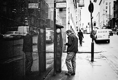 Pay Here (stephen cosh) Tags: life street leica city people blackandwhite bw sepia mono town candid streetphotography rangefinder reallife urbanlife humancondition blackandwhitephotos leicam3 leicam blackwhitephotos stephencosh