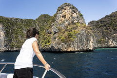 Traveler woman in boat trip (Bugphai ;-)) Tags: trip travel blue sea summer sky woman sunlight seascape tourism nature water girl beauty smiling landscape thailand outdoors island bay boat asia phi maya turquoise traditional culture vessel scene traveller clear deck transportation thai tropical coastline serene nautical phuket relaxation swimsuit idyllic vacations climate tranquil longtail summervacation andaman destinations