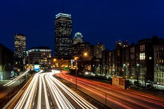 Traffic streaming through downtown Boston, just after sunset.