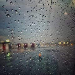 plane thelighttraveler wetravel window bokeh raindrops... (Photo: Mister Blur on Flickr)