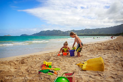 Children Playing at the Beach, Bellows Beach, Hawaii 1 (Julie Thurston) Tags: ocean family blue boy vacation playing mountains beach girl rock horizontal wall kids swimming children fun hawaii kid bucket sand toddler child oahu teal sandy bluewater sunny koolau adventure pacificocean buckets shovel waimanalo bellows cookout familyday beachbag childrenplaying bellowsbeach hawaiivacation hawaiiisland tealwater gettywant