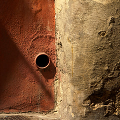 Ancient walls with drain pipe hole (sandroraffini) Tags: street light urban abstract valencia architecture canon spain ancient shadows details textures squareformat walls minimalism surfaces spagna fragments bitchesbrew linescurves dizajnersi blinkagain