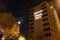 Olympia and 12 othe Cities SHine a Light on Secret TPP Trade Agreement (Backbone Campaign) Tags: action projection nighttime freeway flush activism fasttrack tpp lightprojection backbonecampaign olb corporatecoup overpasslightrigade
