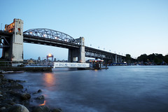 Burrard Bridge at twilight time (Eric Flexyourhead) Tags: ocean longexposure blue sky canada beach water vancouver twilight bc britishcolumbia clear sunsetbeach englishbay bluehour burrardbridge zd 1260mm olympusep1 panasonicdmwma1