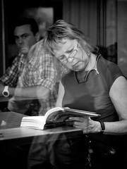 reading Jussi Adler-Olsen (Nicolas Alejandro Street Photography) Tags: world street camera old city portrait people urban bw woman white man black streets eye argentine contrast square lens four photography photo buenosaires focus flickr faces metro live candid documentary going oldman olympus scene best event nicolas micro third format 12mm f18 alejandro 45mm journalism flicker omd streeter 17mm mft em5 nicolasalejandro wwwnicolasalejandrocom