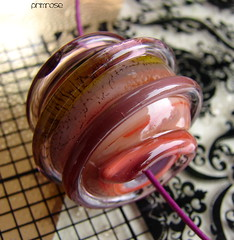 Primrose (Laura Blanck Openstudio) Tags: show green art glass lines rose coral festival giant spiral necklace beads big strawberry shiny colorful published artist purple bright sweet handmade contemporary steel stripes peach violet lavender dramatic wrapped funky jewelry bumpy holes odd lilac single round winner huge amethyst lime transparent dots kiwi kiln murano lampwork beaded multicolor artisan pendant choker stainless bold whimsical raised openstudio focal annealed openstudiobeads