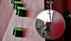 Self Reflection with Green Birdhouses (sea turtle) Tags: seattle red reflection green wall mirror construction birdhouse lightrail redwall seaturtle underconstruction capitolhill birdhouses selfie constructionproject suttonberesculler lightrailconstruction greenbirdhouse greenbirdhouses