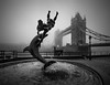 Obscured by Clouds II (vulture labs) Tags: city uk urban blackandwhite bw sculpture mist london art girl monochrome fog thames skyline architecture clouds towerbridge river photography photo nikon cityscape dolphin monotone monochromatic cityoflondon obscuredbyclouds bwlondon d700 vulturelabs