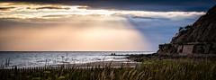 West Shore Sunlight (Fairy_Nuff (new website - piczology.com!)) Tags: light sea cloud sun west beach wales north shore rays llandudno