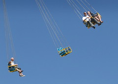 Southport Swings (Tony Worrall Foto) Tags: park uk family vacation england sky people sun fling yellow metal skyline kids turn children fun seaside chair holidays ride northwest candid north fast sunny bluesky fair visit tourist swing resort event tall sunlit excitement funfair excite southport thrill starflyer southportpleasureland 2013tonyworrall