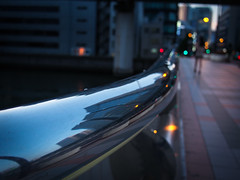 skyscraper reflections (hyossie) Tags: bridge sunset reflection lamp japan evening streetlight dof bokeh olympus panasonic  osaka handrail omd higobashi em5 20mmf17