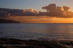 Sunset along the North Shore Hawaii (Julie Thurston) Tags: sunset vacation beach nature water sailboat relax island hawaii boat paradise waves oahu peaceful northshore hawaiian tropical hawaiiansunset aloha waterscape hawaiianislands orangesunset hawaiisunset ilovehawaii hatural hawaiiislands