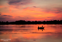 Sunset Fishing (Greg Lundgren Photography) Tags: sunset sky orange lake reflection water silhouette yellow clouds boat fishing magenta centerville