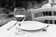 A Glas Of Water (TablinumCarlson) Tags: leica sea bw white black beach water strand lunch 50mm restaurant chair aegean greece summicron tavern m8 sw tisch griechenland glas stuhl marmaras taverne makedonien chalkidiki neos halkidiki sithonia mittelmeer chalkidike  gis chalcidice  makedonica