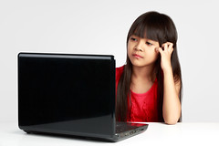 Stressful little asian girl working on laptop, Isolated on grey background (Patrick Foto ;)) Tags: school portrait people white cute home girl beautiful childhood modern computer notebook asian thailand person grey pc kid student education keyboard pretty technology child sad looking classroom serious little desk expression background laptop internet young bored lifestyle social problem study tired thai angry learning network lesson homework stress learn isolated