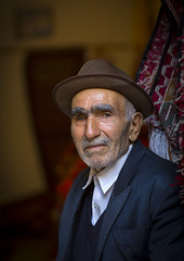 Old Man With A Hat Inside The Old Bazaar, Tabriz, Iran (Eric Lafforgue) Tags: people colour men vertical asia adult iran middleeast unesco worldheritagesite indoors males bazaar adultsonly oneperson frontview headandshoulders kurdish tabriz senioradult traveldestinations colorimage lookingatcamera  onemanonly  islamicrepublicofiran 1people  iro  westernasia  iran0421