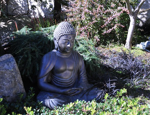 Statue of Buddha in meditation position, garden, View Ave NW, Seattle, Washington, USA