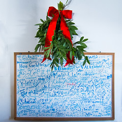 Holiday Greetings (hjl) Tags: hello california blue red color green sign square sunnyvale holidays whiteboard wreath welcome languages seasonsgreetings s100 asteriagrill