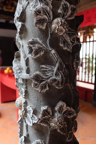 Granite carvings of birds, peonies and leaves