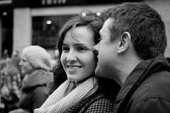 Sweet Nothings (Leanne Boulton) Tags: urban street candid portrait portraiture man woman couple love loving sweet close closeness tender moment pretty girl beauty beautiful brunette cold winter weather warm clothing shop store town centre center busy pavement sidewalk footpath pedestrian area zone smile smiling face facial eyes kiss kissing whisp