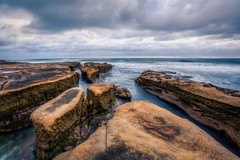Sunset Obstruction (Justin in SD) Tags: ocean sunset cloud beach rock clouds canon coast rocks afternoon pacific cloudy dusk rocky lajolla pacificocean coastal shore canon5d 32bit lajollashore canon5dmarkiii 5d3 5dmark3 32bithdr