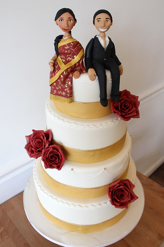 Gold Ribbon Indian Bride and Red Roses Wedding Cake