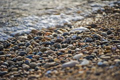 pebbles polished by receding waves (HHH Honey) Tags: minolta minolta100200mm sonya7rii sea seaside seascape beach waves pebbles seaton jurassiccoast