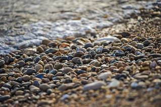 pebbles polished by receding waves