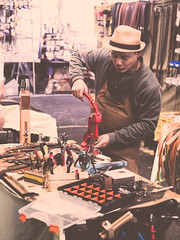 Belt Holes (Jon Cartledge) Tags: craftsman craftsmanship skills local merchant sale customer belt leather tanner omd minolta konica olympus rokkor mrokkor adapted adapter m43 lens prime vintage saturated vignetting pastel dreamy toning shadow contrast warm smooth golden cuts cold deli butter produce markets victoria vic queen market people street colour