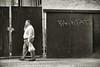 back fat (bytegirl24) Tags: street nyc newyorkcity bw man wall graffiti manhattan sidewalk backfat
