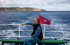 A Journey (The_Kevster) Tags: ocean leica travel blue sea portrait sky man water clouds bench person boat waves ship wind bokeh flag rail rangefinder cliffs journey mann railing isleofman manx irishsea summicron50mm ellanvannin leicam9
