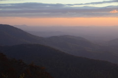 Blue Ridge Sunrise (Christopher Wallace) Tags: pink blue trees sky orange cloud sun mountains color colour nature colors beautiful clouds forest sunrise spectacular early woods nikon colorful soft pretty colours purple bright gorgeous ridge parkway colourful incredible 18200 appalachia blueridgemountains blueridgeparkway ridges muted appalachianmountains layered phenomenal milepost 18200mm jawdropping 18200mmvr nikond7000 holyhellimtired