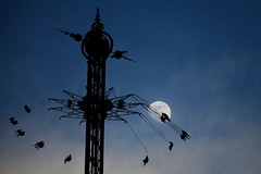 Moonlight Flying (Heaven`s Gate (John)) Tags: park blue sky moon topf25 silhouette gardens copenhagen fun denmark tivoli ride fear structure amusment frightened 10faves 25faves johndalkin heavensgatejohn moonlihgt
