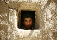Young Boy Looking Out From A Small Window, Amran, Yemen (Eric Lafforgue Photography) Tags: portrait people sun sunlight man eye face childhood horizontal stone youth fun outside person kid asia day child hole outdoor middleeast arabia innocence daytime yemen curiosity oneperson youngpeople onepeople colorphoto dayview youngboy oneboy realpeople lookingatcamera colorpicture placeofinterest whitecolour waistup arabiafelix amran arabianpeninsula 1people youngperson colourpicture blissfularabia