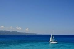 Sail (faithroxy) Tags: blue water seascape caribbean sea sailing sail sailboat jamaica jamaican flag tropical ocean boat montego bay mobay