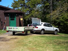 White Buick LeSabre And Utility Trailer. (dccradio) Tags: door trees white ny newyork tree car buick gm adirondacks upstateny greenery trailer lesabre duane generalmotors northernny utilitytrailer homemadetrailer woodtrailer