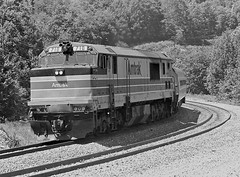 "Amtrak GE P30CH leads the westbound ""Cardinal"" through the West Virginia mountains near Rowlesburg, 1977 (Ivan S. Abrams) Tags: blackandwhite newcastle pittsburgh butler bo ge prr ble conrail alco milw emd ple 2102 chessiesystem westmorelandcounty 4070 bessemerandlakeerie steamtours pittsburghandlakeerie ivansabrams eidenau steamlocomtives ustrainsfromthe1960sand1970s"