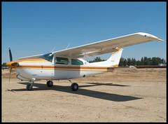 Turbo Centurion II (Dusty_73) Tags: california park light sky plane airplane flying general aircraft aviation flight aeroplane sierra turbo civil ii fresno cessna aero propellor centurion