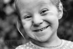 Tess lost her tooth! (thtgrlnamdsam) Tags: camera portrait white black girl smile up tooth lost missing sam little sister kate freckles noise grown thtgrlnamdsam