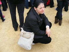 Nina at the Annie World  Record Attempt in Derry (seanfderry-studenna) Tags: world city ireland woman black cute public girl beautiful beauty smile female pose dark hair happy girlfriend long candid gorgeous coat crowd culture posing eire clothes jeans event annie record wife nina persons kneeling handbag attempt derry poeple croatian squatting fiancee serb eireann ebrington