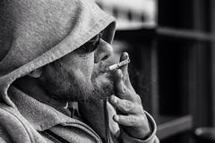 Untill the last millimeter (Giulio Magnifico) Tags: sunglasses closeup hand cigarette candid smoke profile citylife streetphotography streetportrait streetlife hood smoker udine nikond800e nikkormicro105mmafsvrf28