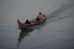 Family travelling down the Shatt Al-Arab, Basra