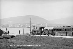 Next stop, America! (National Library of Ireland on The Commons) Tags: valencia valentia kerry ireland munster railwaystation trainstation locomotive107 harbour dog unionflag quay boats carriage train railways railroads robertfrench williamlawrence lawrencecollection glassnegative nationallibraryofireland valenciaharbour valentiaharbour reenardpoint reenard clerestory