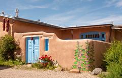 A home in Rancho de Taos Plaza (Snap Man) Tags: newmexico unitedstates taos hollyhocks 2015 alcea taoscounty byrobin nikond90 stfrancisplaza ranchosdetaosplaza