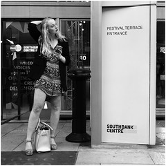 Lady Timotei (mesonparticle) Tags: bw woman london girl mobile phone dress longhair streetphotography cellphone southbank blonde fujifilm x100t topgunning